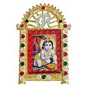 Laddu Gopal on Stone Studded and Golden Carved Metal Frame - Table Top Picture