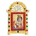 Krishna on Stone Studded and Golden Carved Metal Frame - Table Top Picture