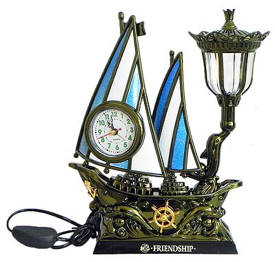 Battery Operated Table Clock in a Plastic Sailing Ship with Lamp