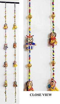 A Pair Of String Wall Hangings With Four Cute Dolls With
