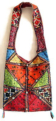 Mirrorwork and Embroidered Multicolor Cotton Bag Decorated with Cowrie