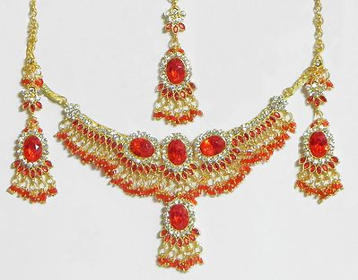 Dark saffron and White Stone Studded Necklace with Earrings and Maang Tikka