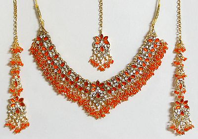 Saffron and White Stone Studded Necklace with Earrings and Maang Tikka