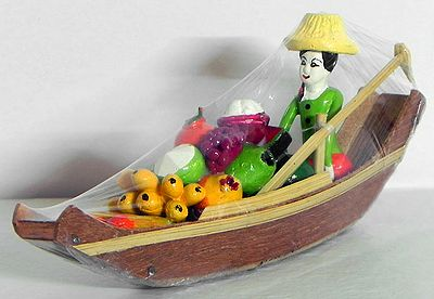 Girl Selling Vegetable and Fruits on Boat