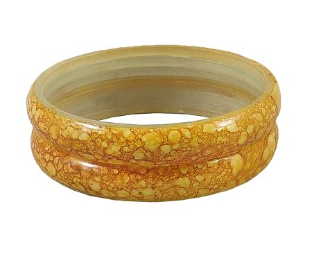 A Pair of Yellow Marble Print Acrylic Bangles