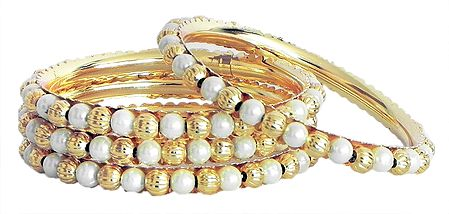 Set of Four Golden and White Bead Bangles