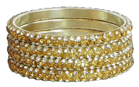 Four Golden with White Stone Studded Bangles