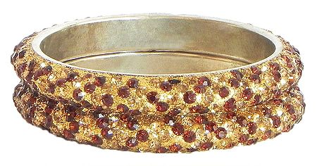 Pair of Golden and Red Stone Studded Bangles