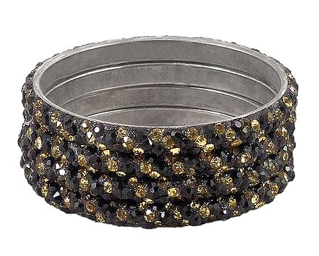 4 Black and Golden Stone Studded Metal Bangles
