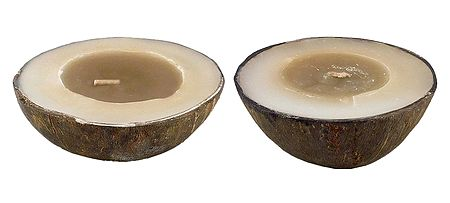 Candles Placed inside Empty Coconut Bowls