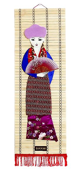 Appliqued Cloth Girl with Fan on Woven Bamboo Strips - Wall Hanging