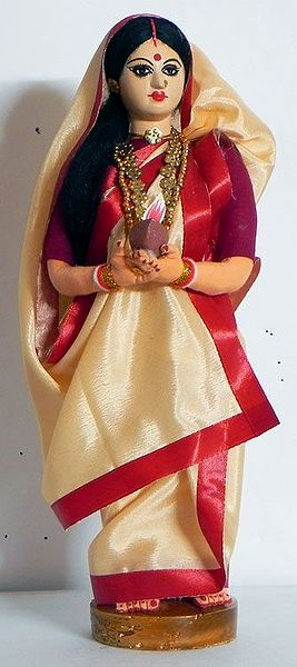 Bengali Pujarini Holding Diya