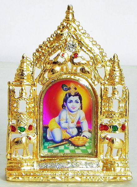 Makhan Chor Krishna on Stone Studded and Golden Carved Metal Frame