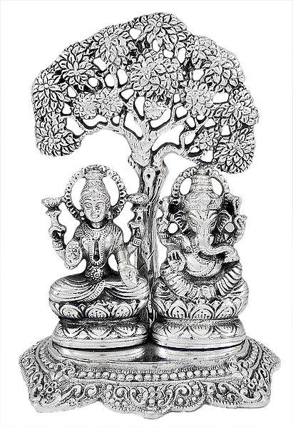 Lakshmi and Ganesha Sitting Under a Tree