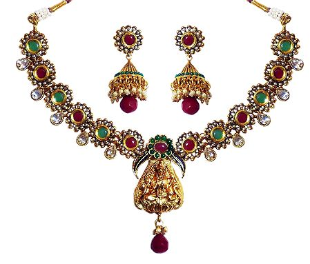 Stone Studded Necklace with Lakshmi Pendant and Earrings