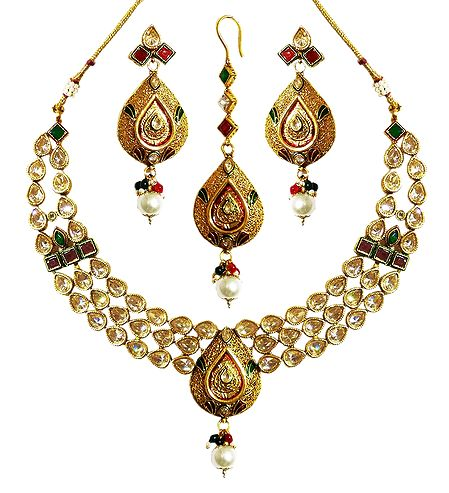 Stone Studded Kundan Necklace with Earrings and Mang Tika