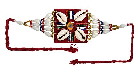 Multicolor Beaded Armlet with Cowrie on Maroon Cloth
