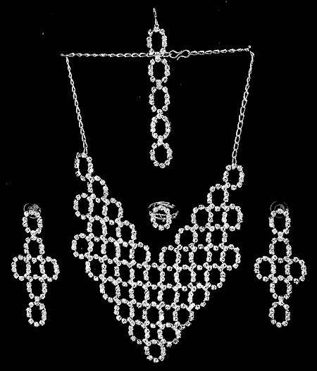 White Stone Studded Necklace, Earrings, Ring and Mang TIka