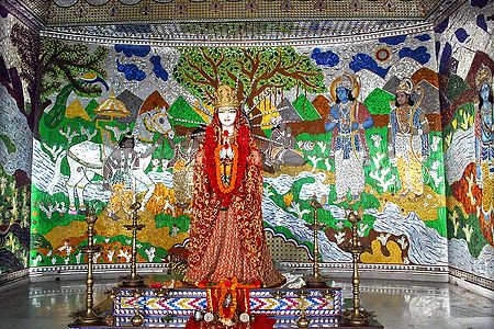 Devi Sita with Ramayana Painting in the Background
