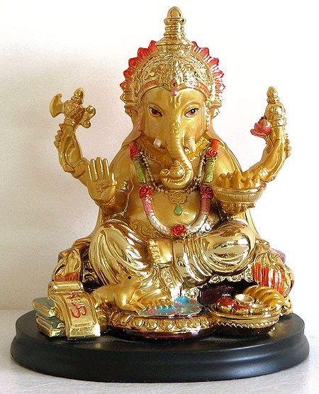 Lord Ganesha with Golden Laddoos