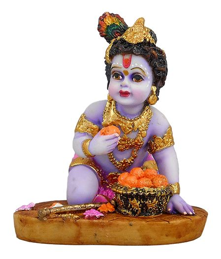 Krishna Eating Laddu