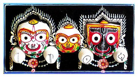 Jagannath, Balaram, Subhadra Face on Decorated Wooden Base - Wall Hanging