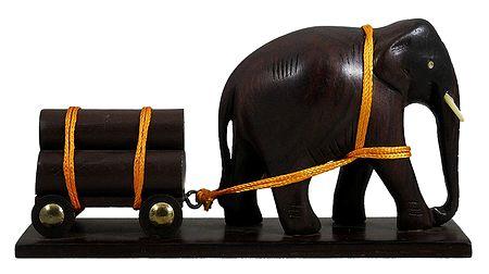 Elephant Carrying Logs