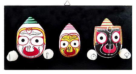 Faces of Jagannath, Balaram and Subhadra on Hardboard - Wall Hanging