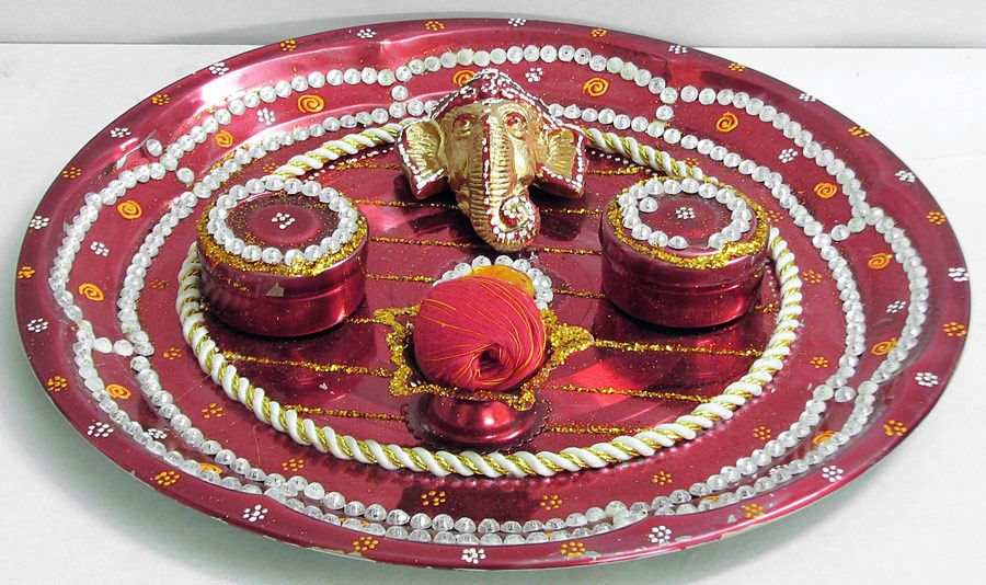 Decorated steel puja thali with ganesha face two sindoor for Indoor diwali decoration