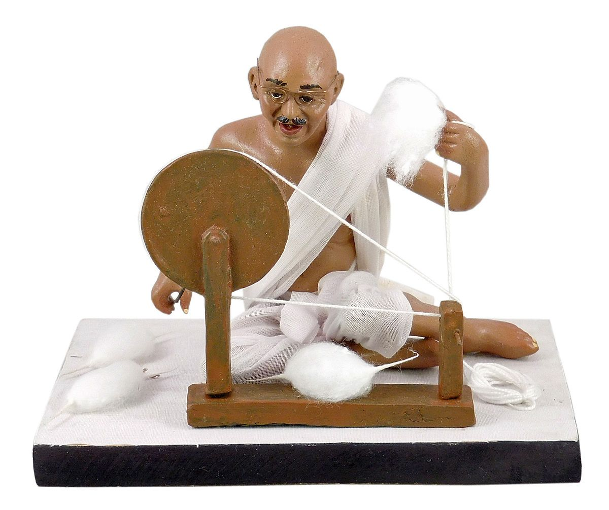 Mahatma Gandhi with his Charkha (Spinning Wheel)