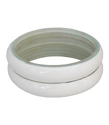 Pair of Off-White Acrylic Bangles
