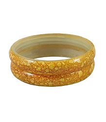 A Pair of Yellow Marble Acrylic Bangles