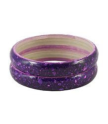 A Pair of Purple Marble Print Acrylic Bangles