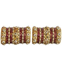 Two Sets of Red and Green Stone Studded Red Churis with Glitter Golden Bridal Bangles