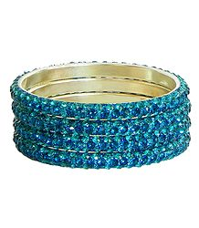 Four Cyan Stone Studded Bangles