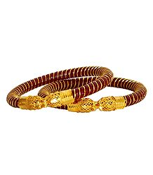 Pair of Gold Plated Red Bangles