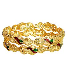 A Pair of Gold Plated Meenakari Bangles