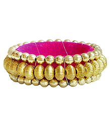 Golden Bead Bracelet with Magenta Cloth Lining