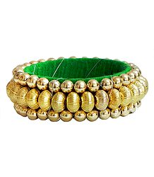 Golden Bead Bracelet with Green Cloth Lining