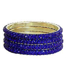 Four Blue Stone Studded Bangles