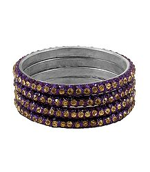 4 Purple and Golden Stone Studded Metal Bangles