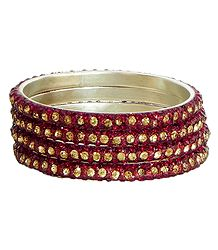 Four Red with Golden Stone Studded Bangles