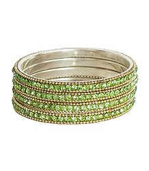 4 Light Green Stone Studded Bangles
