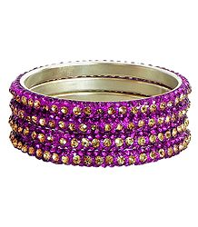 Four Magenta with Golden Stone Studded Bangles