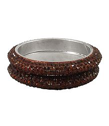 A Pair of Rust Color Stone Studded Bangles