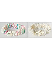 A Pair of White and Multicolor Shell Stretch Bracelet