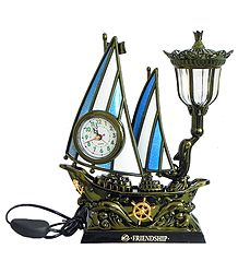 Battery Operated Table Clock in a Acrylic Sailing Ship with Lamp