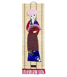 Appliqued Cloth Girl with Fan on Woven Bamboo Strips