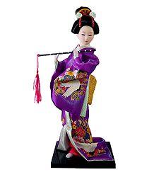 Japanese Doll in Purple Kimono Dress Holding Flute