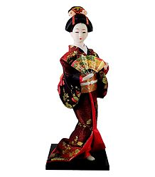 Geisha Doll in Dark Red Kimono Dress Holding Fan